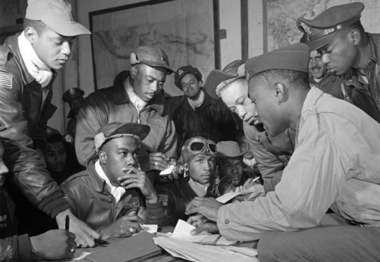 Several Tuskegee Airmen at Ramitelli, Italy, March 1945. Photo by Toni Frissell, Library of Congress.